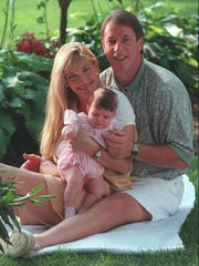 Jim Kelly at home with his fiancee, Jill Waggoner, and the couple's 4-month old daughter, Erin, in 1995.