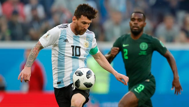 Argentina's Lionel Messi controls the ball against Nigeria.