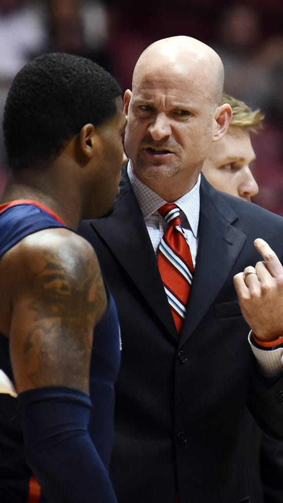 Mar 3, 2015; Tuscaloosa, AL, USA; Mississippi Rebels coach Andy Kennedy talks with guard Martavious Newby (1) during a timeout in the first half against the Alabama Crimson Tide at Coleman Coliseum. Mandatory Credit: Kelly Lambert-USA TODAY Sports