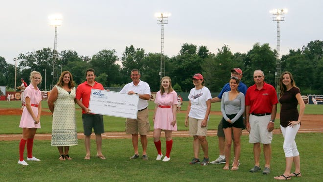 A check for $10,000 was presented during the Dubois County Bombers' game on Monday. From left to right: Sienna Crews, Sara Schroeder, Clayton Boyles, Kevin Manley, Grace Kappner, Mary Uebelhor, Mike Uebelhor, Amanda Tempel, Jim Rueger, and Whitney Hall.
