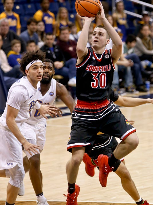 Louisville's Ryan McMahon (30) shoots after getting by Pittsburgh's Parker Stewart, left, during the second half of an NCAA college basketball game, Sunday, Feb. 11, 2018, in Pittsburgh. Louisville won 94-60. (AP Photo/Keith Srakocic)