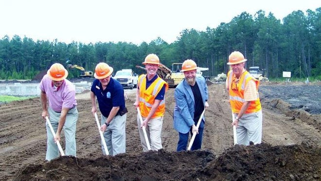 A groundbreaking ceremony was held July 24 for Crete Solutions, which is building a new facility at Camp Davis Industrial Park in Holly Ridge. Pictured left to right are: Onslow County Commissioners Mark Price and Royce Bennett, Bill West of Crete Solutions, Holly Ridge Mayor Jeff Wenzel and John Allen of Crete Solutions.