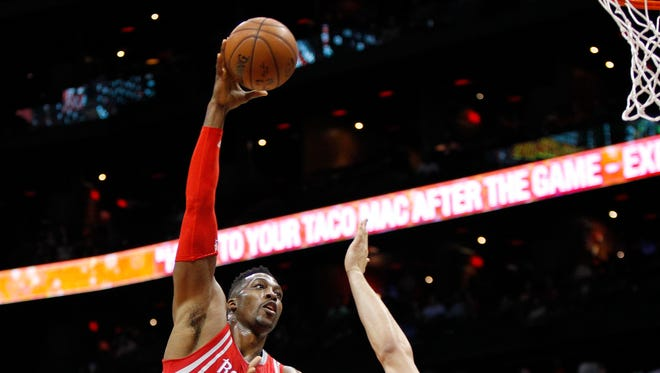 Houston Rockets center Dwight Howard (12) shoots the ball against the Atlanta Hawks in the first quarter at Philips Arena.