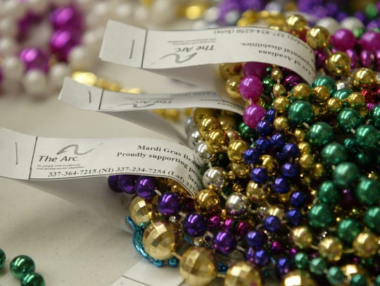 Mardi Gras beads sorted and labeled by ARC clients