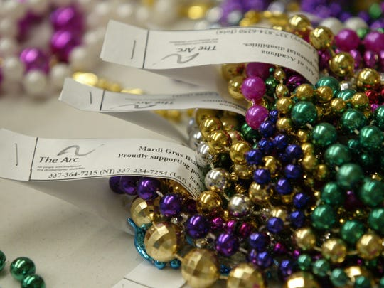 Mardi Gras beads sorted and labeled by ARC clients with developmental disabilities are seen Thursday at the ARC of St. Landry in Grand Coteau, La.