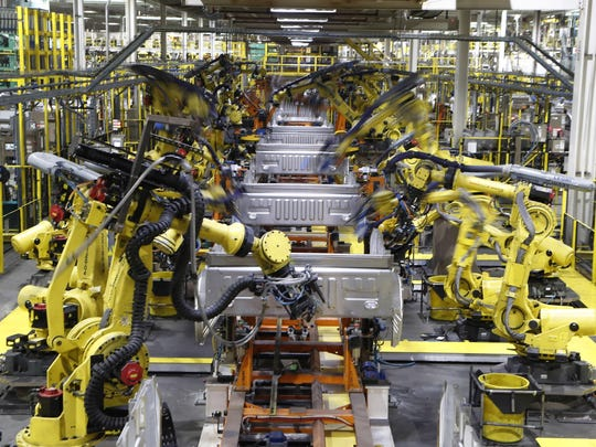 In this Sept. 27, 2018, file photo robots weld the bed of a 2018 Ford F-150 truck on the assembly line at the Ford Rouge assembly plant in Dearborn.