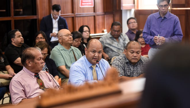 Guam Department of Education Superintendent Jon Fernandez, center, replies to an inquiry from Sen. Régine Biscoe Lee during a public hearing at the Guam Legislature in Hågatña on Thursday, June 1, 2017.