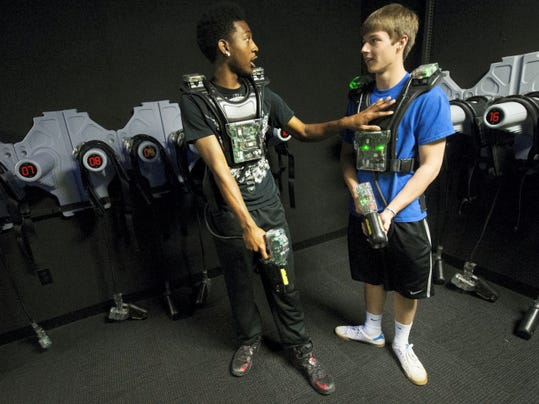 South Western High School students Darius Rowlett, left, and Tanner Fuhrman strategize before entering the room in partial darkness April 28 at Hickory Falls Family Entertainment Center in Penn Township.