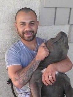 Adrian Arias-Ruiz with his dog, Sumo