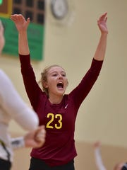 McAuley's Olivia Brackett celebrates a point against