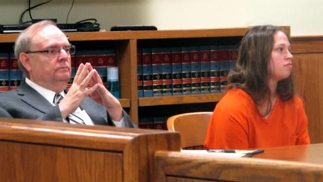 Brittany Pilkington, right, listens as a judge sets a $1 million bond in the case in which Pilkington is accused of suffocating her three sons over 13 months, with her attorney, Marc Triplett, beside her, on Thursday, Aug. 20, 2015, in Bellefontaine, Ohio.