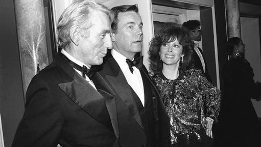 """In this 1985 file photo, Jill St. John, right, with Robert Wagner, center, and Rod McKuen, left, attend a party for """"Night of 100 Stars II,"""" in New York. McKuen, the husky-voiced """"King of Kitsch"""" whose music and verse recordings won him an Oscar nomination and made him one of the best-selling poets in history, has died on Thursday. He was 81."""