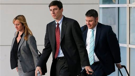 Attorney Jeff Matura (middle) representing the town of Colorado City, Ariz., and attorney Blake Hamilton, representing the town of Hildale, Utah, leave the Sandra Day O'Connor United States District Court after a day of testimony during a federal civil rights trial against two polygamous towns on the Arizona-Utah line on   Tuesday, Jan. 26, 2016, in Phoenix.