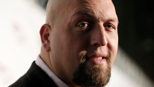 """FILE - In this Friday, Aug. 21, 2009, file photo, WWE Wrestler Big Show arrives at the World Wrestling Entertainment SummerSlam kickoff party benefiting Betty's Battle in Los Angeles. A story reported by a blog called """"WWE"""" that claimed professional wrestling star """"Big Show"""" had died in a car accident is false. Chris Bellitti, a spokesman for World Wrestling Entertainment, Inc., said Tuesday, Dec. 27, 2016, that the """"Big Show,"""" whose real name is Paul Donald Wight II, is alive and well."""
