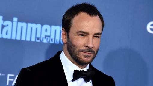 "FILE - In this Dec. 11, 2016 file photo, Tom Ford arrives at the 22nd annual Critics' Choice Awards in Santa Monica, Calif. The Wynn Las Vegas hotel has stopped selling Tom Ford cosmetics and sunglasses and President-elect Donald Trump declared on television it's because of the designer's dis over dressing his wife, Melania. Trump said in an interview that aired Tuesday night, Jan. 17, 2017, on the Fox News Channel's ""Fox & Friends"" that hotel owner Steve Wynn ""said he thought it was so terrible what Tom Ford said, that he threw his clothing out of his Las Vegas hotel."""