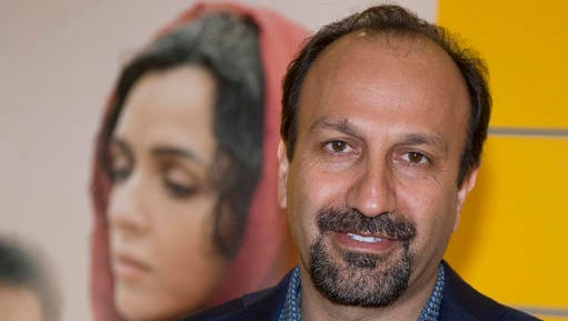 """FILE - In this Oct. 10, 2016 file photo, Iranian director Asghar Farhadi poses for a photo during the premiere of his film, """"The Salesman, in Paris. The motion picture academy calls """"extremely troubling,"""" the possible visa ban of Iranian director Farhadi, whose feature film """"The Salesman"""" is nominated for a best foreign language Oscar. In a statement released Saturday, Jan. 28, 2017, the Academy of Motion Picture Arts and Sciences expressed concern that Farhadi and his cast and crew may not be permitted to attend next month's Oscar ceremony in Los Angeles following President Trump's plan to temporarily suspend issuing visas for people from Iran and six other Muslim countries."""