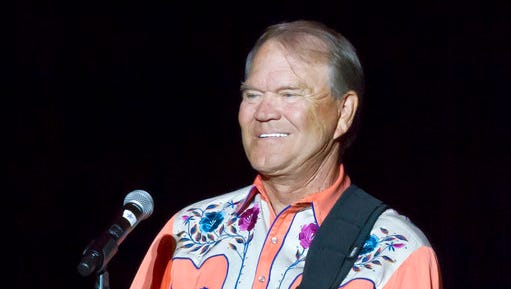 "FILE - This Sept. 6, 2012 file photo shows singer Glen Campbell performing during his Goodbye Tour in Little Rock, Ark. Campbell is releasing his final studio album, which was recorded shortly after his Alzheimer's disease diagnosis in 2011. The record label, Universal Music Enterprises, announced Friday, April 14, 2017, that the album, ""Adios,"" will be released on June 9."