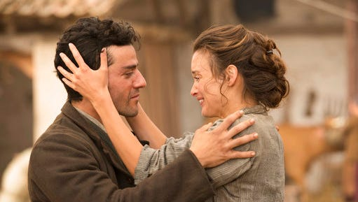 """This image released by Open Road Films shows Oscar Isaac , left, and Charlotte Le Bon in a scene from """"The Promise."""""""