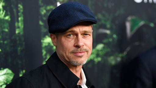 """FILE - In this April 5, 2017, file photo, Brad Pitt arrives at the Los Angeles premiere of """"The Lost City of Z"""" at the ArcLight Hollywood. Pitt told GQ Style magazine for an interview published online May 3, 2017, that he quit drinking since Angelina Jolie filed for divorce in Sept. 2016."""