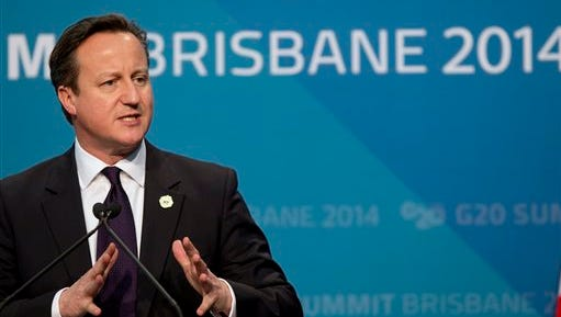 FILE - This is a Sunday, Nov. 16, 2014  file photo of  British Prime Minister David Cameron as he addresses a press conference at the conclusion of the G-20 summit in Brisbane, Australia. Britain's Prime Minister David Cameron has offered a bleak assessment of global economic prospects, comparing potential troubles to red warning lights on a car's dashboard. Writing in a piece in the Guardian newspaper after returning from the G-20 summit in Australia, Cameron said Monday Nov. 17, 2014  that a lack of growth in Europe and conflicts in the Middle East and Ukraine add to the backdrop of instability. (AP Photo/Mark Baker, File)