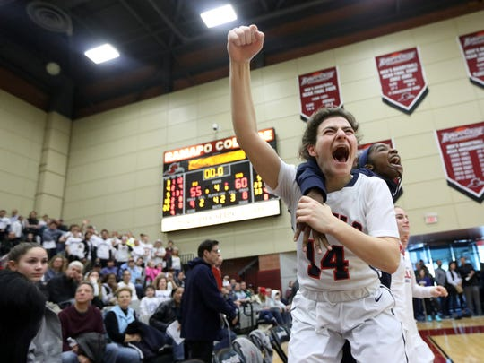 Jordan Janowski and other players on the Saddle River Day School bench celebrate as the clock runs out for Pascack Valley.  The Rebels won, 60-55, to claim the Bergen County Women Coaches Association Championship, in Mahwah, Sunday February 18, 2018.