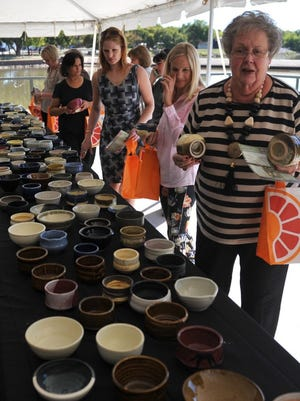 Guests look at bowls offered at the annual Empty Bowls fundraiser at the Wichita Falls Museum of Art at MSU during the 2016 event. This year's event will be held Oct. 3.