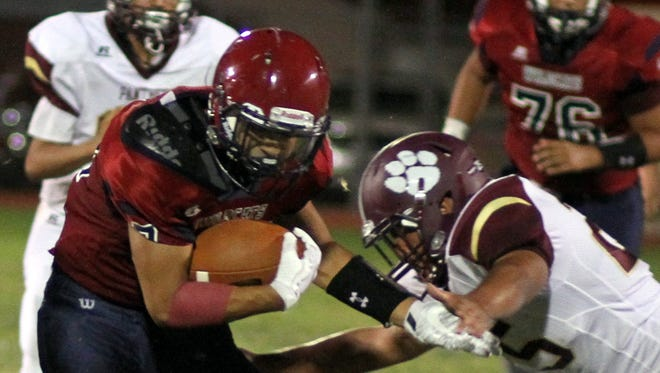 Junior Cat back Trini Garcia II turned in some tough yards during Deming's 22-9 victory over Gadsden high last week.