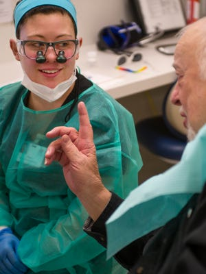 Cecil Gurganus of Evansville, right, shares stories with his dental hygienist, Paige Hall, a senior at the University of Southern Indiana, Wednesday morning. Gurganus, a veteran, had his teeth cleaned minutes earlier by Hall.