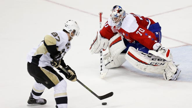 Pittsburgh Penguins center Sidney Crosby (87) prepares to score a goal on Washington Capitals goalie Braden Holtby (70) in overtime at Verizon Center.