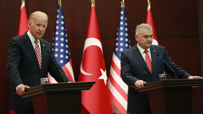 Vice President Joe Biden and Turkish Prime Minister Binali Yildirim hold a joint press conference following their meeting Wednesday at the Cankaya Palace in Ankara. Biden said Washington had made clear that pro-Kurdish forces in Syria must not to cross west of the Euphrates River, a prospect alarming for Turkey. His comments come after Turkish troops launched an operation inside Syria to cleanse the key town of Jarabulus from Islamic State jihadists.