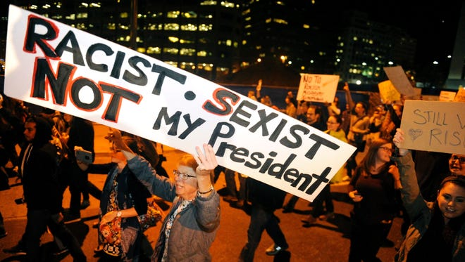 Demonstrators protest the election of President-elect Donald Trump in Denver.