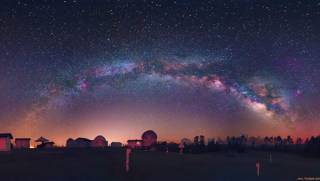 The Milky Way is observed over the Rainwater Observatory and Planetarium in Choctaw County.