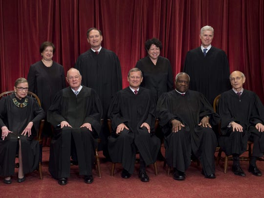 Justices of the Supreme Court sit for their official