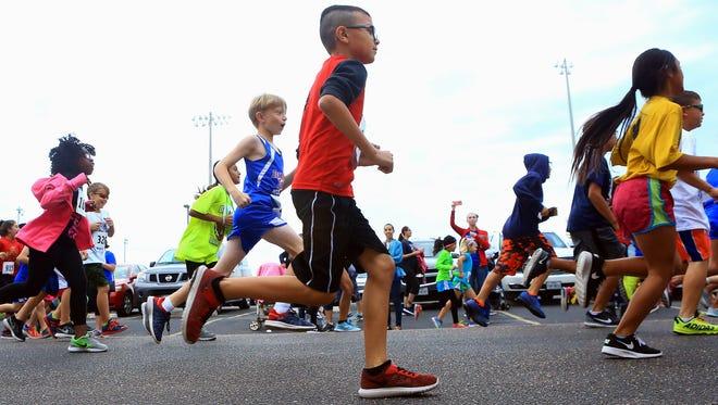 GABE HERNANDEZ/CALLER-TIMESKids run 1.8 miles during the annual Mission FitPossible Fun Run/Walk on Saturday, Nov. 12, 2016, at CCISD Cabaniss Field in Corpus Christi.