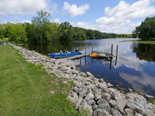 Who Owns Upper Spring Lake After Investors Built Dam State Lays