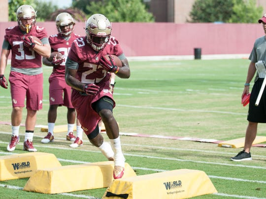 Freddie Stevenson performs a drill as Florida State begins preparations for the 2015 football season with the first day of Fall Camp on Thurs., Aug. 6.