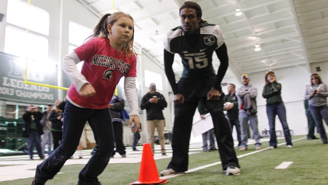 Trae Waynes works MSU's youth football clinic in 2014 at the Duffy Daugherty Football Building. The Minnesota Vikings cornerback is back in East Lansing this weekend to help coach at the Spartan Elite one-day camp for rising high school seniors.