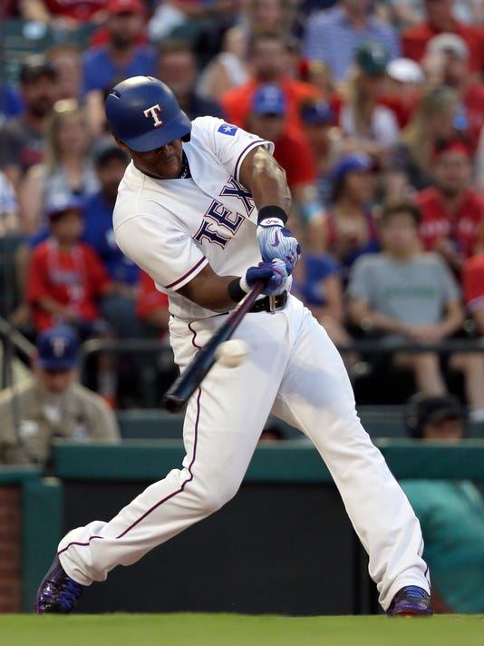 Texas Rangers' Adrian Beltre connects for a two-run single off a pitch from Seattle Mariners' James Paxton in the third inning of a baseball game, Friday, June 16, 2017, in Arlington, Texas. The hit scored Shin-Soo Choo and Elvis Andrus. (AP Photo/Tony Gutierrez)
