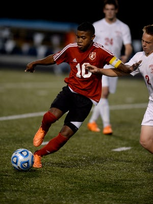 Richmond's Denis Herrera moves the ball against Connersville's Jordan Carsey during a sectional soccer game Wednesday, Oct. 7, 2015, on Lyboult Field at Richmond.