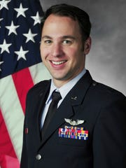 This undated photo provided by the U.S. Air Force shows Capt. Andrew Becker from Novi, Mich. Becker was one of three service members killed Tuesday, March 14, 2017, in the crash of a reconnaissance and surveillance plane during a training flight in eastern New Mexico.