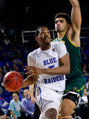 MTSU's Nick King, shown here in a March NIT game against Vermont, is getting a look from the Grizzlies as a potential second-round draft pick.