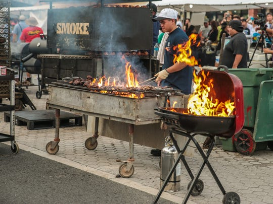 Meats are grilled during the BBQ competition at the