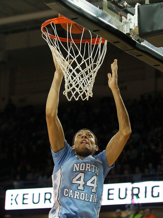 North Carolina guard Justin Jackson (44) scores during the first half of an NCAA college basketball game against Boston College in Boston, Tuesday, Feb. 9, 2016. (AP Photo/Stew Milne)