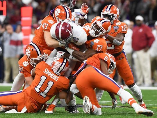 Clemson's defense brings down Alabama defensive back Trevon Diggs (7) during the 2nd quarter of the Allstate Sugar Bowl at the Mercedes-Benz Superdome in New Orleans on Monday, January 1, 2018.