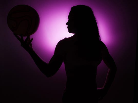 Silhouette Of Girl Sspinning Basketball On Finger