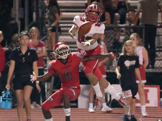 Fairfield's Erick All (83) goes up for the ball over