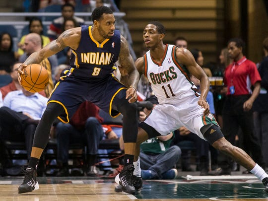 In 2014, then-Indiana Pacers guard Rasual Butler (8) dribbled the ball as Milwaukee Bucks guard Brandon Knight (11) defended during a game at BMO Harris Bradley Center.  Jeff Hanisch/USA TODAY Sports