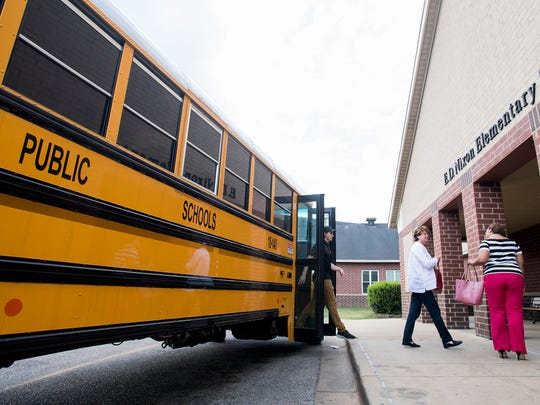 Unloading at E.D. Nixon Elementary School during a bus tour of schools in Montgomery, Ala. on Thursday March 29, 2018.