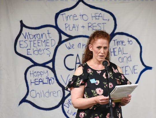 Sharon Koltes takes a turn to speak during a gathering