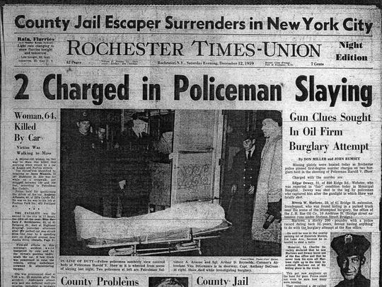 Front page of Rochester Times-Union from Dec. 12, 1959. Rochester police officer Harold V. Shaw was shot and killed by burglers.